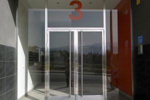 Puerta y portal comunitario en acero inoxidable 11