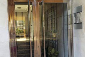 Puerta y portal comunitario en acero inoxidable 26